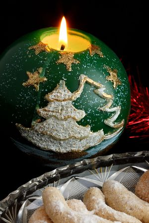 Christmas sweets on a glass plate with lit christmas candle Stock Photo - 3758406