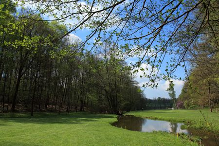 fairway of a beautiful golf course with lake