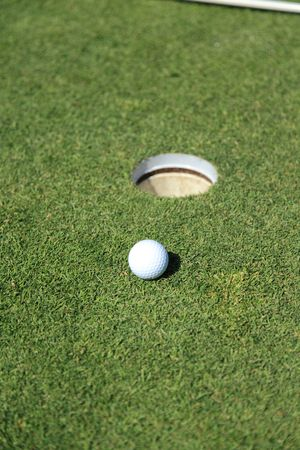golf ball on a green of a beautiful golf course photo