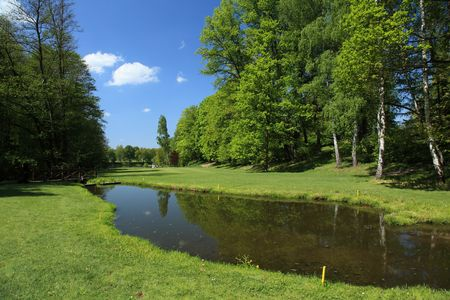 fairway of a beautiful golf course with lake photo