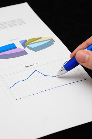 Hand with pen showing diagram Stock Photo - 7148305