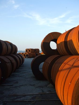 steel: Coils of Steel in shipping yard with water in background