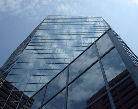 reflects: Mirrored Building Reflects Sky Stock Photo