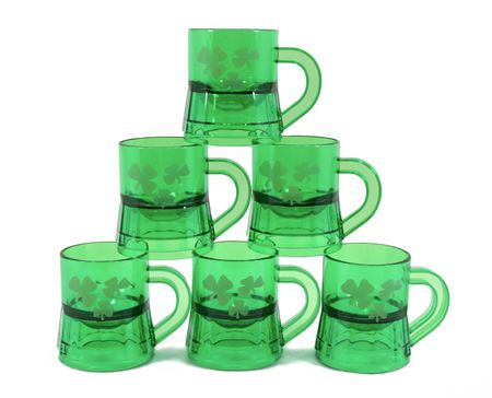 Six St. Patrick's Day themed mugs are piled in a pyramid, isolated on a white background. Stock Photo - 2530898