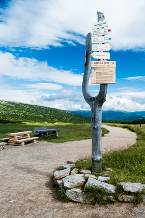 SPINDLERUV MLYN, CZECH REPUBLIC - JULY 29, 2016: The wooden sign for tourists near the spring of river Elbe (Labe). Place is located in the first zone of the National park Krkonose in the altitude of 1380m on the Labska meadow near Labska bouda. Editöryel