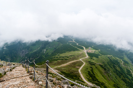 The way to the highest mountain in Krkonose National Park, Snezka. Foggy, windy and wet weather, the view of the ridge lost in cloud. Stock Photo
