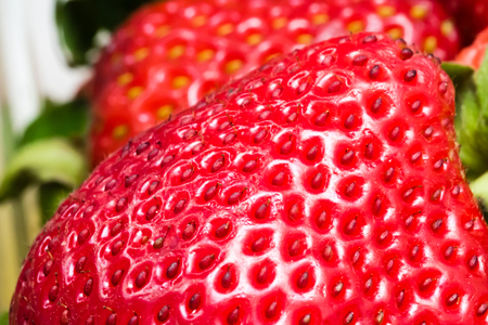 Detail of red strawberry. Shallow depth of field, macro photography.