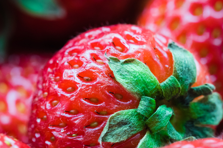 background: Detail of red ripe strawberry. Shallow depth of field, macro photography. Stock Photo