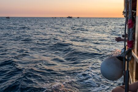 View of water and waves while sailing on the sea. Waves, part of ship and horizon. Reklamní fotografie