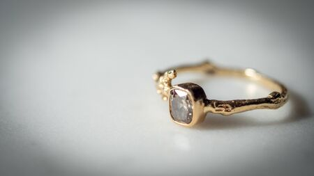 engagement ring on marble table Imagens