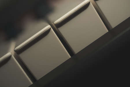 The skewed detail of the dusty cinematic old vintage electrical piano keyboard. Stockfoto