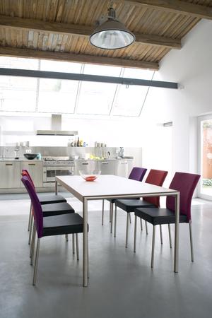 architectural lighting design: modern kitchen interior with 6 chairs