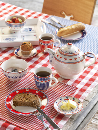 bread and butter: Easter breakfast with tea, bread, butter and strawberries Stock Photo