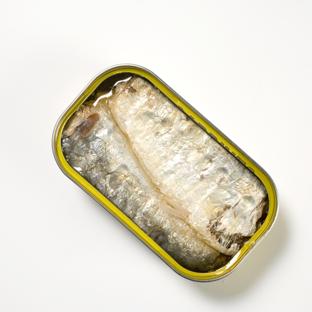 can of sprats on white background Banco de Imagens