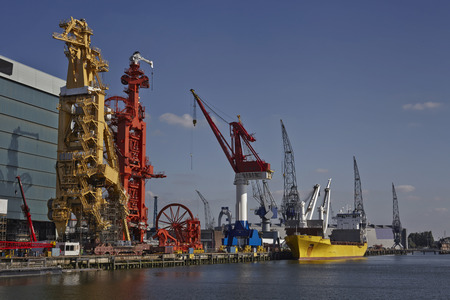 subsea: cargo vessel on the port of rotterdam with several cargo cranes