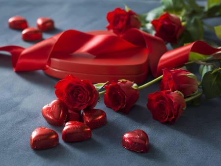 Bunch of red roses and box with red hearts. Valentines Day concept Stock Photo