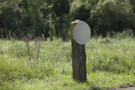 White blank round sign in nature back ground