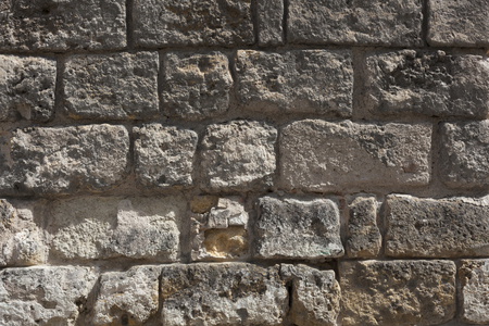 Medieval Old wall from a stone brick of gray color