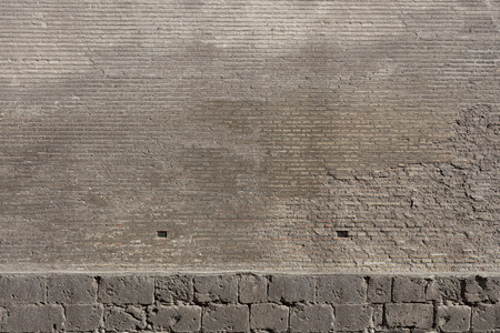 Texture of a Old wall from a stone brick of brown color