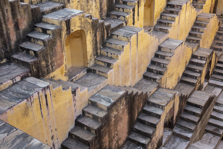 the stepwells of Chand Baori, in Jaipur, India. It was built as a monument to the goddess of joy and happiness, Hashat Mata, India