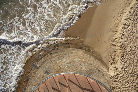 Aerial view of sandy beach and ocean with waves, spain 版權商用圖片