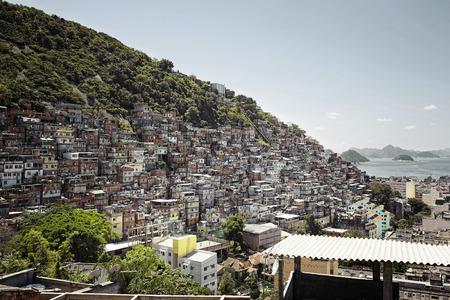 Houses stand on a hill in the Rocinha slum of Rio de Janeiro, Brazil Stock Photo