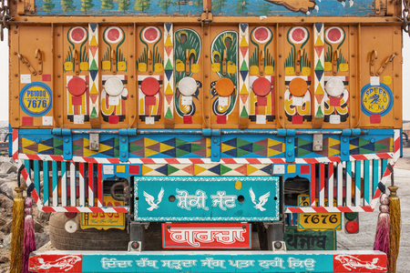 Brigt and colorful traditionally pained Indian lorry on the street