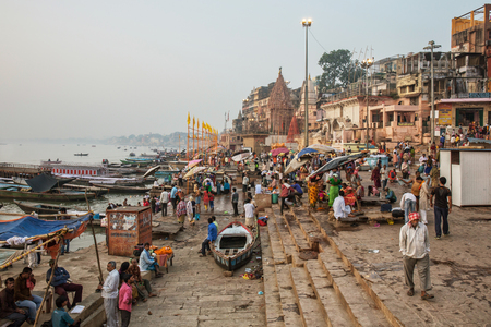 People wash and bath in Ganges river at one of the many ghats of Varanasi Old City