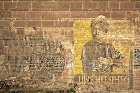 Yellow grey india grafitti in Varanasi, India Editorial