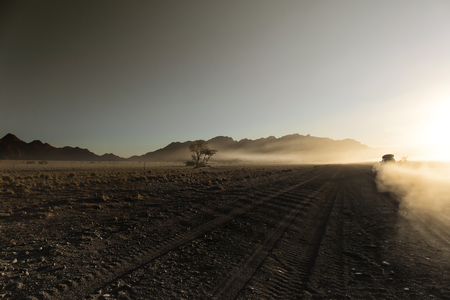 Endless empty dirt road in Namib desert of Namib-Naukluft National Park, Namibia, Africa Imagens