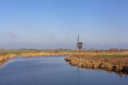 Windmill the Achterlandse molen near the Dutch village Groot-Ammers in the region Alblasserwaard - Image