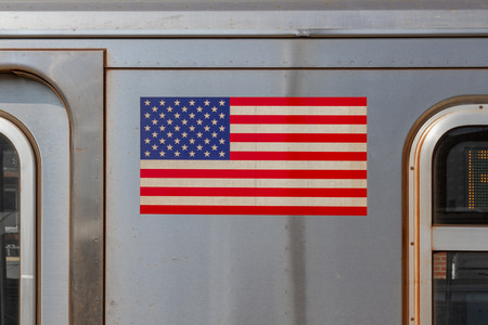 subway line in New York City with the flag of the USA