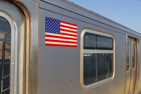 New York subway line in New York City with the flag of the USA
