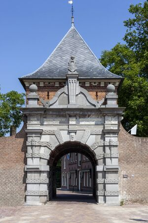 Medieval archway to the port of the picturesque village Schoonhoven near the river Lek in the Netherlands