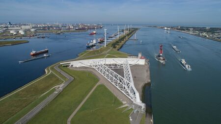 Aerial picture of Maeslantkering storm surge barrier on the Nieuwe Waterweg Netherlands it closes if the city of Rotterdam is threatened by floods and is one of largest moving structures on earth Banco de Imagens
