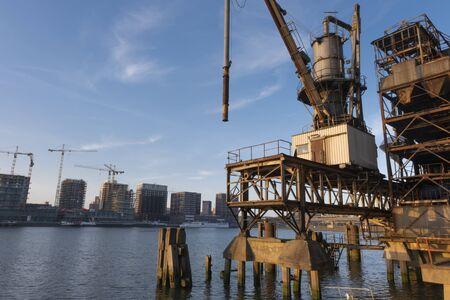 old fashion rusty Port grain elevator. Industrial sea trading port bulk cargo zone in Rotterdam harbour