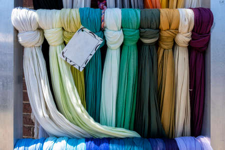 Colorful scarves at a market in the Netherlands. Colors of textiles