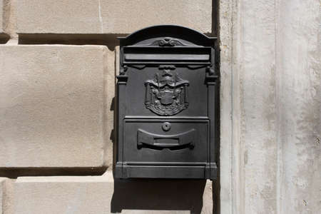 Old Italian mailbox on the wall. Cassetta per le lettere means letterbox, Regie poste means royal post.