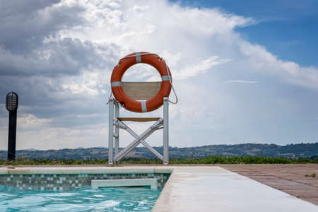 Holiday Swimming pool and a lifebuoy