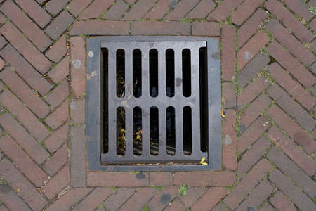 sewer manhole cover in a city street in the Netherlands