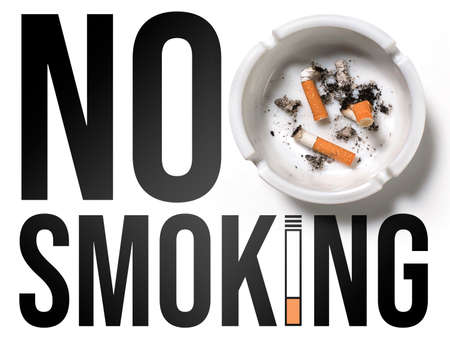 No smoking sign on white with an ashtray and cigarettes