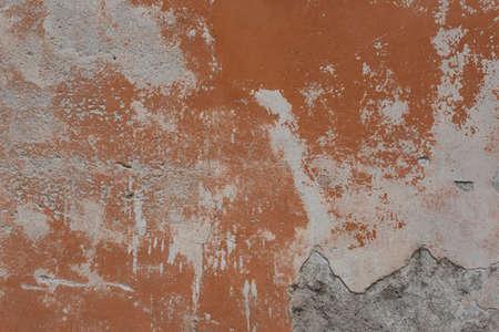 old cracked damaged plaster wall background