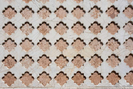 Side wall decorated with white stone of the Cathedral in Perugia, region of Umbria, Italy. 免版税图像