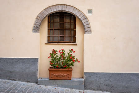 Spello, Perugia, Umbria, Italy. Typical alley with potted plants and flowers.