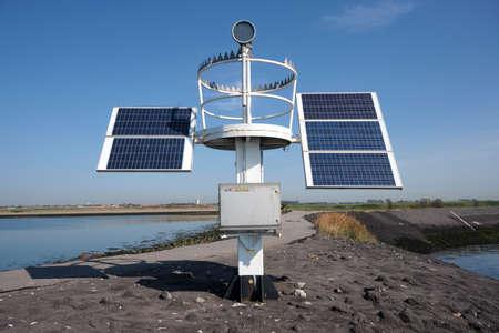 solar panel for lake harbor lighthouse energy, blue sky.