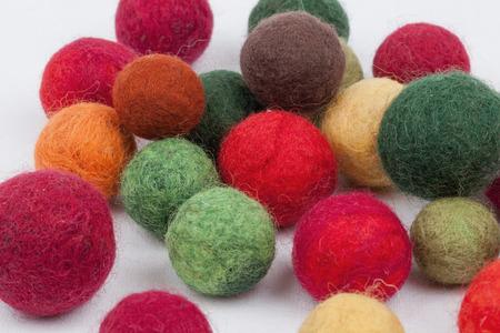 Multi-colored cotton balls photo