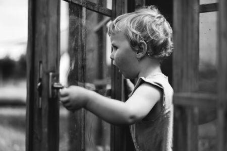 Little girl playing. Monochrome portrait