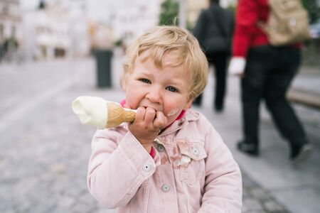 Portrait of little girl with ice cream