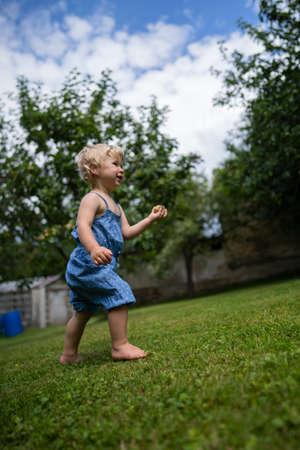 Little girl playing in garden