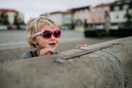 Little girl with sunglasses in city